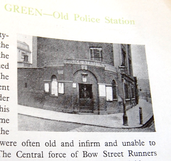 photo from book showing single roomed Police Station with the attending officer looking out of the  top half of the stable door.