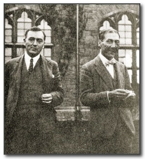 geoffrey shaw (left) and Martin Shaw (right) in front of the ornate windows of a stone building