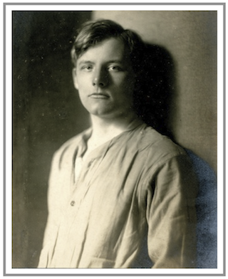 sepia studio portrait of a young man with open-necked collarless shirt and single buttons