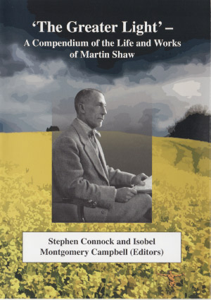 black and white photo o Martin Shaw looking into the distance superimposed on a field of yellow flowers